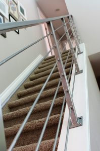 modern metal horizontal guardrail down stairs