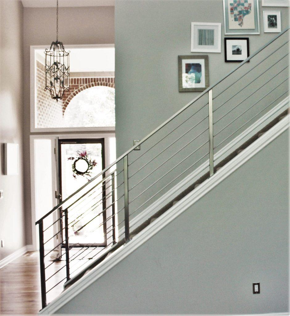 modern metal horizontal bars railing down stairs