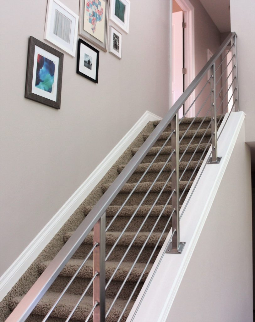 interior horizontal railing down carpet stairs