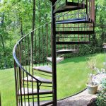 brown metal spiral staircase wood treads wrought iron railing wood deck builder safe curved steel staircase glass handrail steel system backyard landscaping