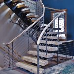 curved interior staircase butternut wood treads horizontal metal railing wrought iron rail wood top steel tree stairs