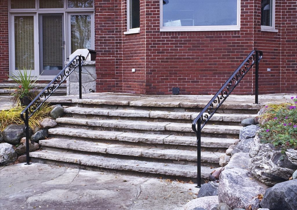 double wrought iron step rails lake home landscape stairs