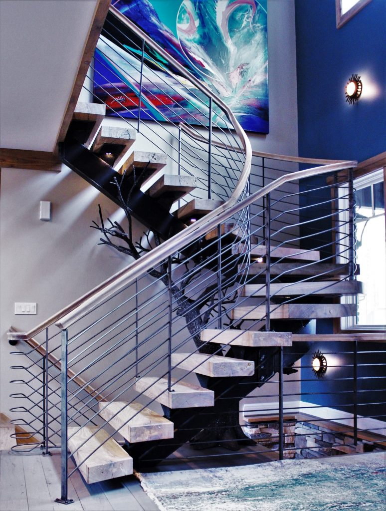 artistic interior curve staircase floating wood treads steel stairs horizontal metal wrought iron railing tree hardwood custom