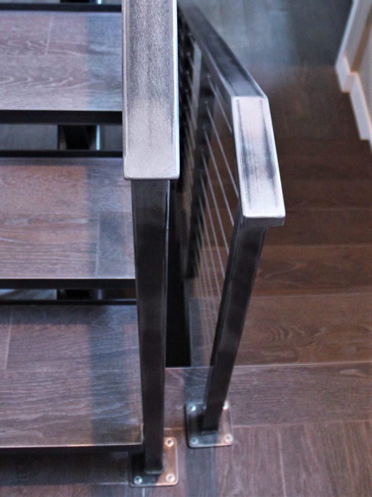raw steel cable rail industrial style metal stairs floating treads wood floor steel stringer contemporary modern rustic vintage