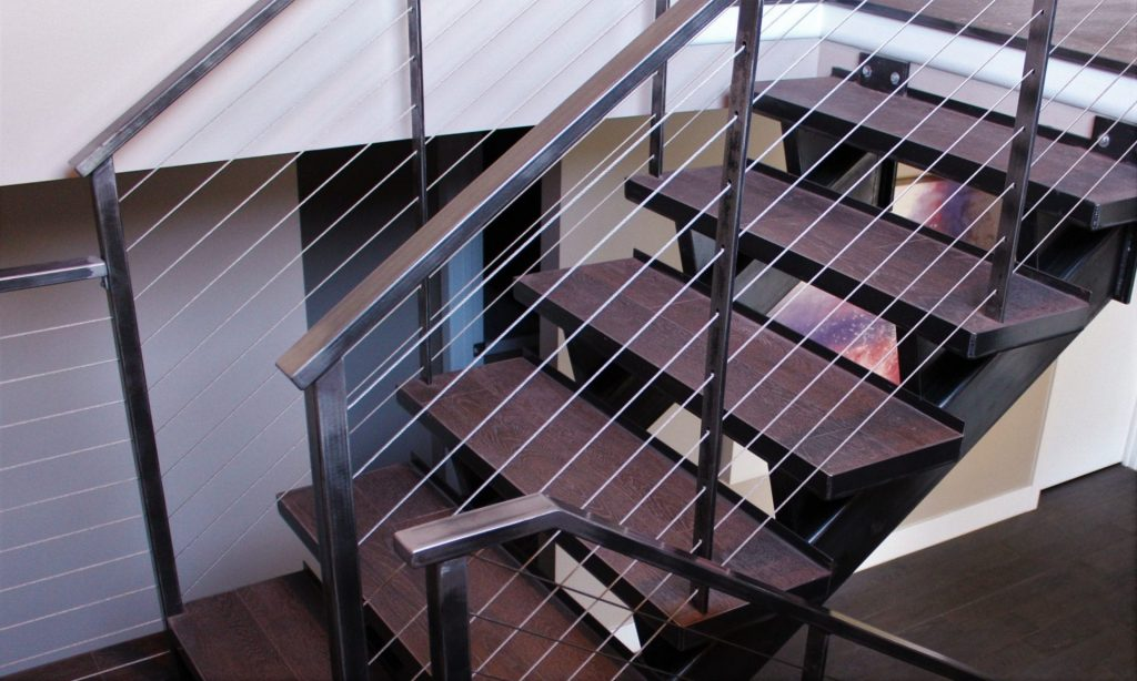 raw steel cable rail industrial style metal stairs floating treads wood floor steel stringer contemporary modern rustic vintage eclectic interior design new construction lake home