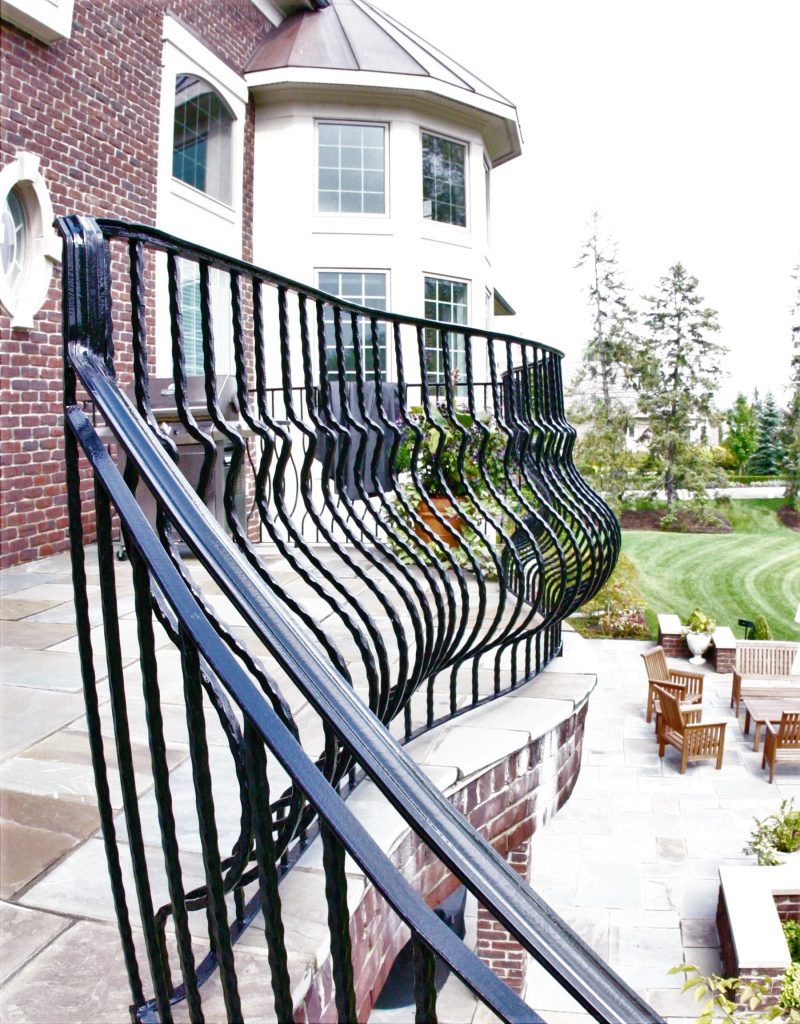 wrought iron belly rail on brick deck
