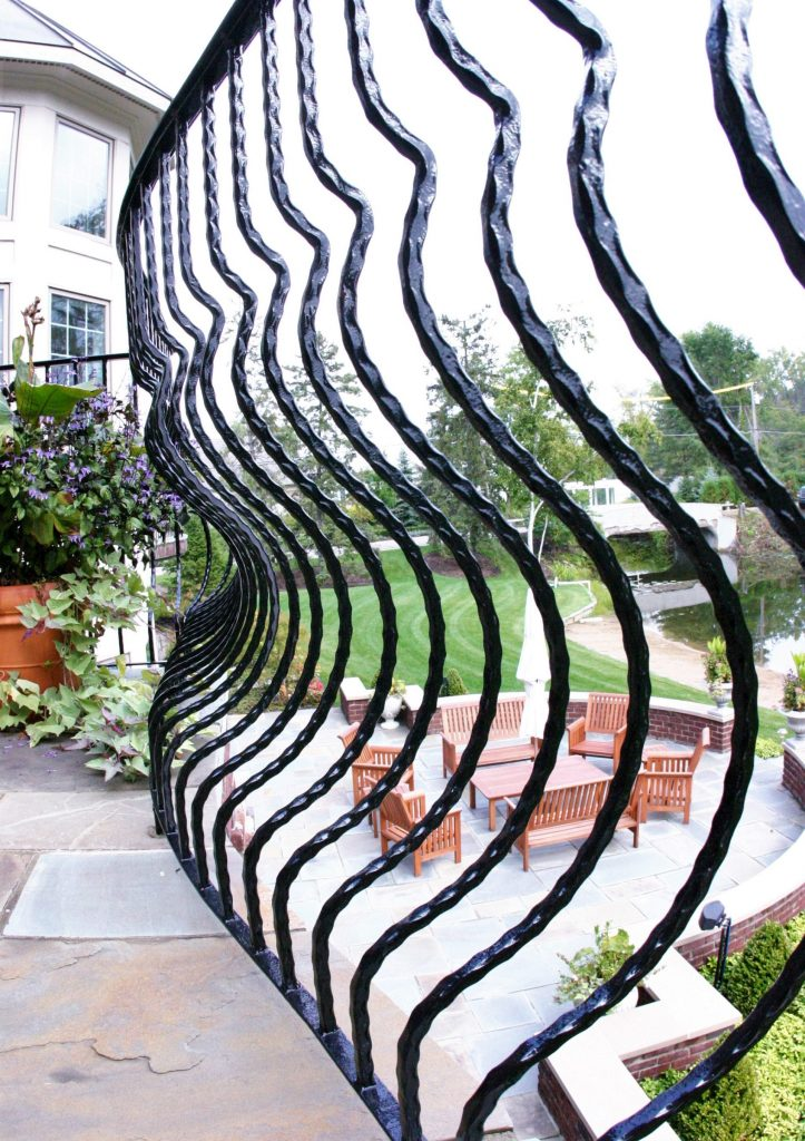 curved belly railing wrought iron railing