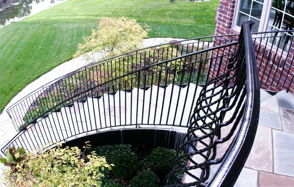traditional wrought iron railing down curved staircase curved stairs