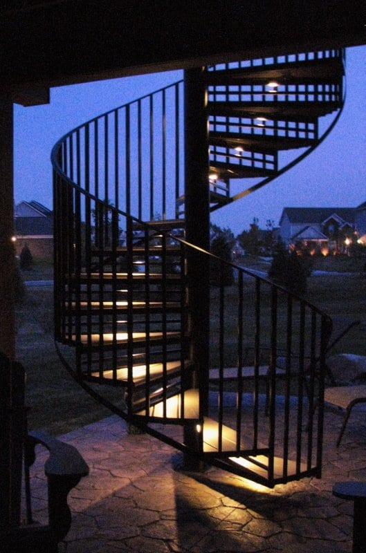 trex wood deck iron spiral stair led lighting treads iron spiral stair helix stair curved staircase circular stairs contractor michigan