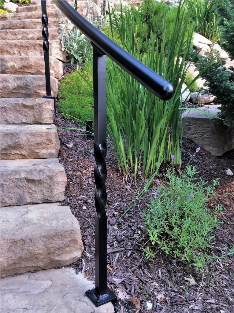 lakehouse landscaping curved steps metal handrail twisted posts side mount wrought ironr railing concrete stairs hardscape forged steel newel