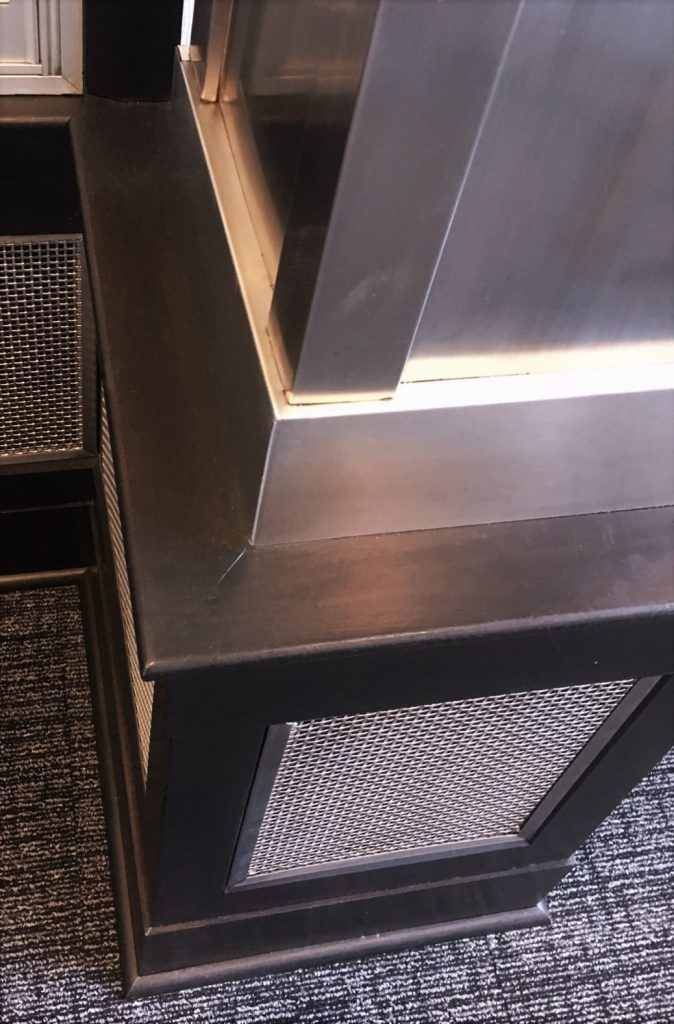 stainless steel architectural accents column wrapped mesh metal wainscoting panels art deco railing interior design staircase entry lobby Detroit