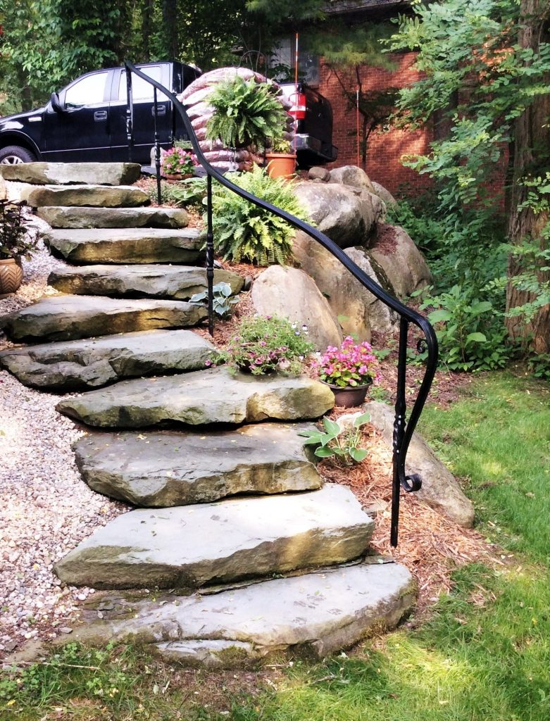 stone landscape steps slip fall hazard residential metal stair handrail curved ends decorative wrought iron posts safe railing cost per foot installed