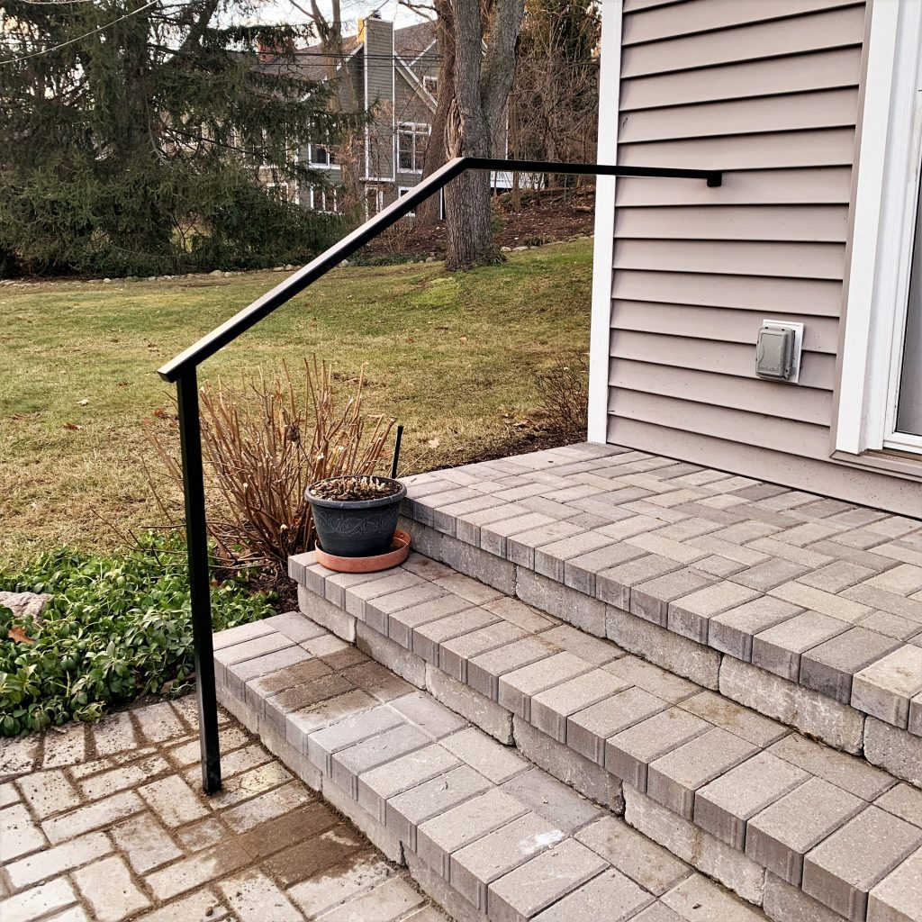 black rectangular handrail at paver steps rail aluminum wrought iron powder coat metal grab railing