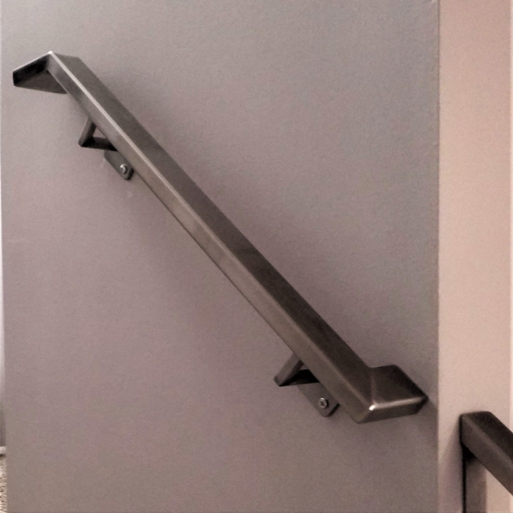 square metal brushed stainless steel rail wall mounted graspable handrail drywall square brackets attached metal handrail wall returns interior metal stair rail downstairs on curb