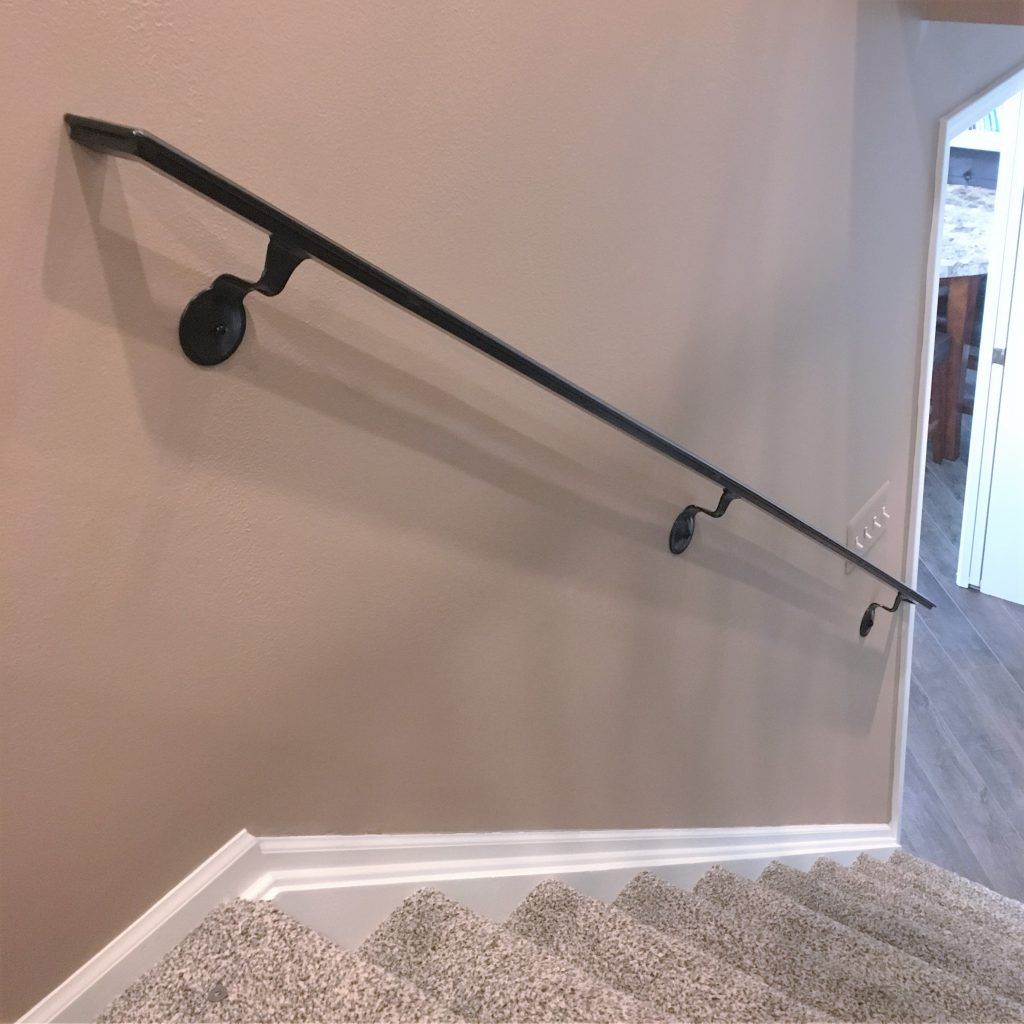 steel wrought iron wall mounted graspable handrail drywall round brackets attached metal handrail wall returns circle hanger interior metal stair rail downstairs