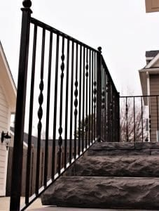 metal ribbon twist picket side stair porch rail wrought iron rod iron handrail twisted spindles stone patio paver step railing