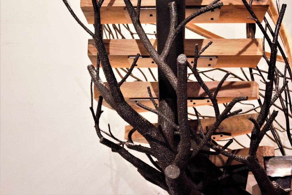 curved floating staircase curved steel string center support stairs thick wood solid treads metal tree sculpture rustic railing