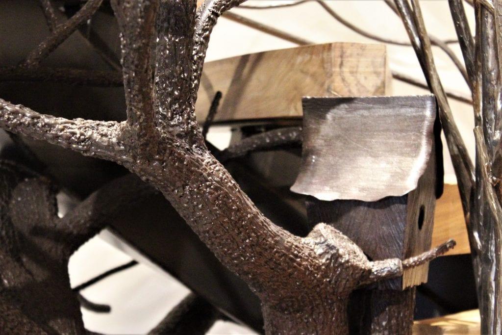 metal tree sculpture steel treetrunk bark texture metal birdhouse birdcage wood treads curved floating staircase