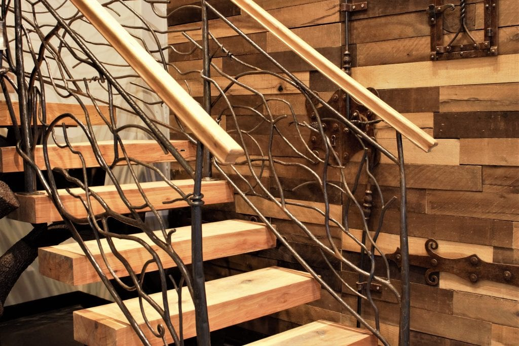 metal tree sculpture steel treetrunk bark texture thick wood treads curved floating steel staircase pallet wall rustic metal railing artistic iron metal fabrication