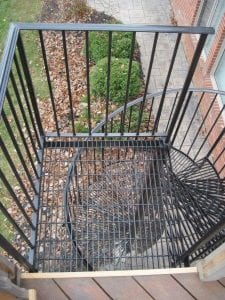metal bargrate spiral stair iron spiral stair see thru treads metal grating treads staircase steel stairs metal railing wood deck egress