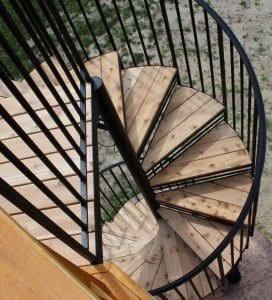 cedar deck wrought iron spiral stair sunroom brick deck home tall steel spiral staircase curculr stair wood treads metal railing michigan stair contractor