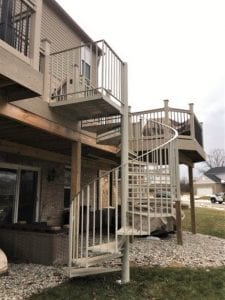 welded iron spiral staircase with metal railing wood treads trex wood deck brick home walkout basement backyard subdivision livonia michigan