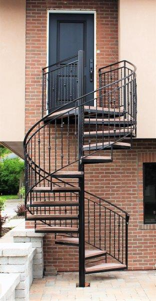commercial iron spiral stair concrete treads meatl railing twisted helix stair circular stairs wrought iron rail contractor plymouth michigan