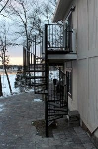 wrought iron spiral stair exterior curved staircase wood deck metal railing circular stair contractor michigan