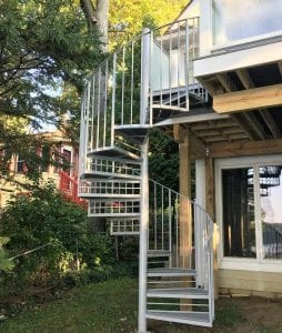 lakefront glass railing wrought iron spiral stair exterior steel staircase metal railing curved stairs circular stair contractor michigan trex deck