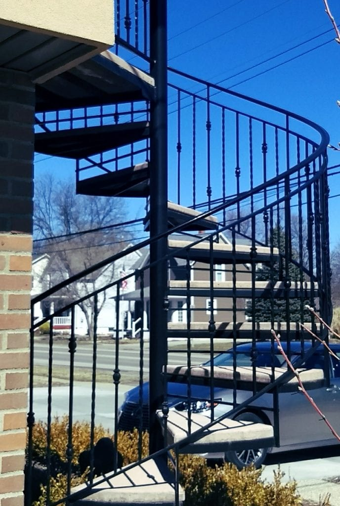 spiral stair concrete treads metal railing twist circular helix stairs wrought iron spiral contractor michigan