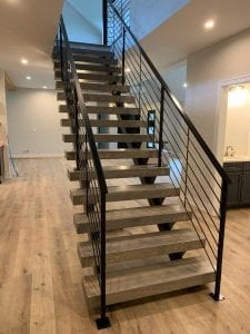double stringer floating stair metal railing horizontal bars wrought iron rail wood treads modern home hardwood flooring