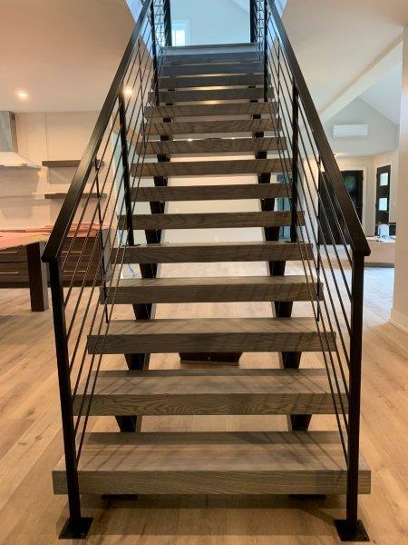 double stringer floating stair metal railing horizontal bars wrought iron rail wood treads modern home hardwood flooring