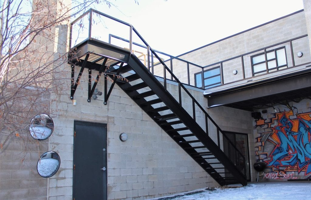 straight steel mezzanine stairs metal staircase industrial treads commercial stair stringers graffiti block wall detroit stairs
